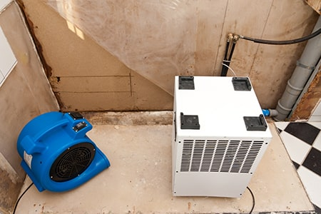 Restoration of Water Damage with Fan and Dryer